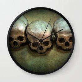 Three human skulls Wall Clock