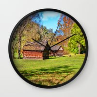 allyson johnson Wall Clocks featuring Johnson City Tennessee Cabins by Mary Timman