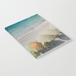 Umbrellas on the beach Notebook