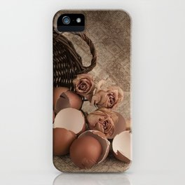Basket with egg shells and roses iPhone Case