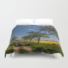 Spring landscape- a trail in the rapeseed Duvet Cover