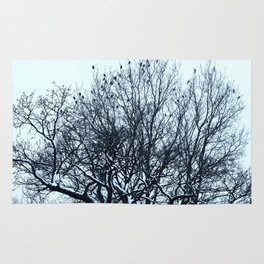 A flock of birds sitting on a tree on a winter day. Rug