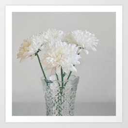 Creamy white flowers in clear vase. Art Print