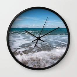 In contact with water Wall Clock