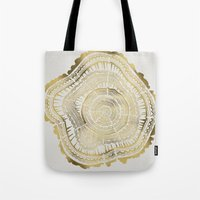 black and gold Tote Bags featuring Gold Tree Rings by Cat Coquillette
