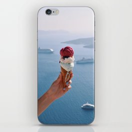 Hand holding melting ice cream in Santorini iPhone Skin