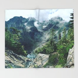 Mountain through the clouds Throw Blanket