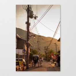 Man pulls his rickshaw down a street in Arashiyama, Kyoto, Japan Canvas Print
