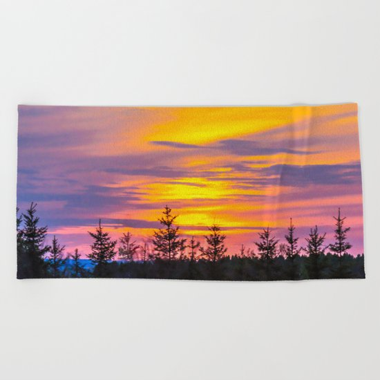 Sunset above the forest Beach Towel