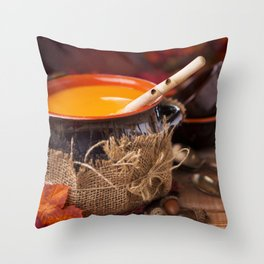 Homemade pumpkin soup on a rustic table with autumn decorations Throw Pillow