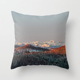 Sunset at spruce forest and mountains. Throw Pillow