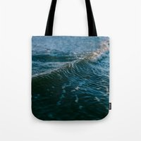 gravity Tote Bags featuring Gravity by Leah Flores