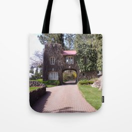 Beautiful Rock Building With Stone Path Through It Surrounded by Green Tote Bag