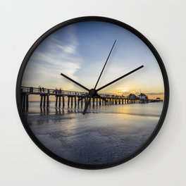 Sunset over Naples Pier in Florida from the beach Wall Clock