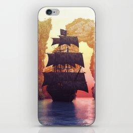 A pirate ship off an island at a sunset iPhone Skin