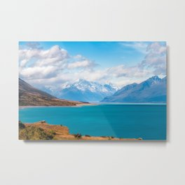 Blue waters of Lake Pukaki with snow-capped Mount Cook in the background in New Zealand Metal Print