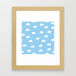 White clouds in blue background Framed Art Print
