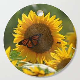 The butterfly the bee and the sunflower Cutting Board