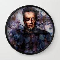 christopher walken Wall Clocks featuring Christopher Walken Terminator by Jay Gidwitz
