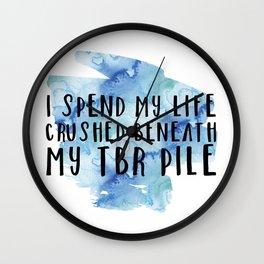 I Spend My Life Crushed Beneath My TBR! (Blue) Wall Clock