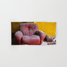 old red armchair abandoned in a disused warehouse Hand & Bath Towel