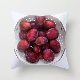 Some violet plums in a white glazed colander. Throw Pillow