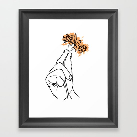 A Hand with a Flower Framed Art Print