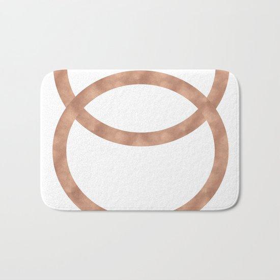 Rose gold circles of infinity Bath Mat