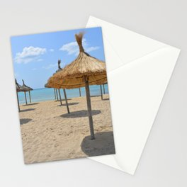 Parasols in a row on a sunny beach Stationery Cards