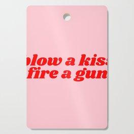 blow a kiss fire a gun Cutting Board