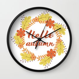 Hello Autumn written with brush pen in Wreath with colorful leaves and flowers. Wall Clock