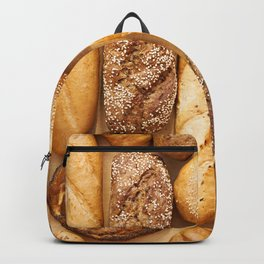 Bread baking rolls and croissants background Backpack