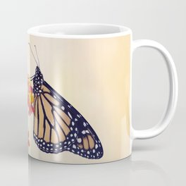 Monarch Butterfly  feeding on Tropical milkweed Coffee Mug