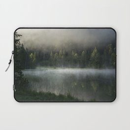 Magic Misty Lake. Amazing shot of a wooden house in the Ferchensee lake in Bavaria, Germany, in front of a mountain belonging to the Alps. Scenic foggy morning scenery at sunrise. Laptop Sleeve