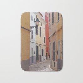 sunlit narrow cobbled quiet - ciutadella Bath Mat