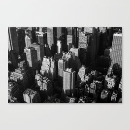 Tall buildings and skyscrapers with shadows of each other in the evening Canvas Print