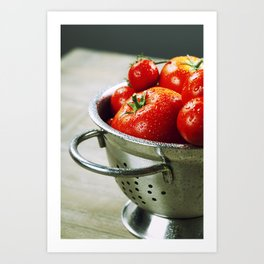 fresh tomatoes (in metal colander) and herbs on a wooden table Art Print