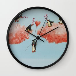 penguins celebrate the arrival of a new friend Wall Clock