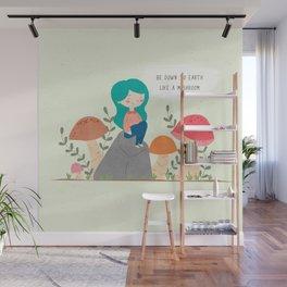 Be down to earth like mushroom; Cute girl sitting on stone Wall Mural