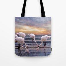 Flamingos feeding Tote Bag