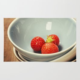 Strawberries in a Bowl on wooden background Rug