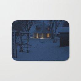 Snowy House at Dusk Bath Mat