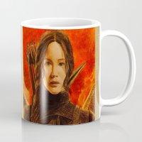 katniss Mugs featuring Katniss Everdeen by Tiffany Singh