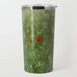 Seed Head With A Beautiful Blur of Poppies Background Travel Mug