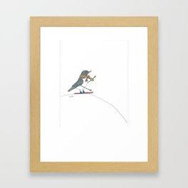 Bird on skis. Framed Art Print