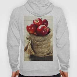 Burlap sack with apples on a wooden table Hoody