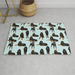 Black and Tan Coonhounds on light blue Rug