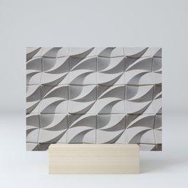 White waves on building Mini Art Print