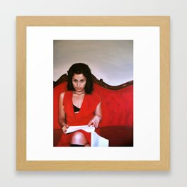 Woman on a Red Couch Framed Art Print