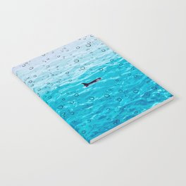 Orca Whale gliding through the water on a rainy day Notebook